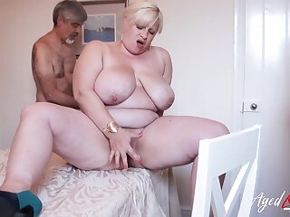 Horny band together is playing with hairy mature pussy of well-endowed blonde