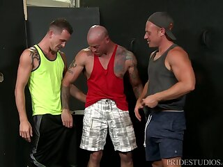 Detached troika with mature guys after a hard workout
