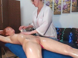 Redhead Gets An Erotic Massage From Girlfriend