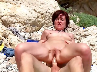 Naughty sexual adventure for the naked mature while on holiday