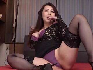 Clothed Japanese matured is ready to wee bit the brush undies