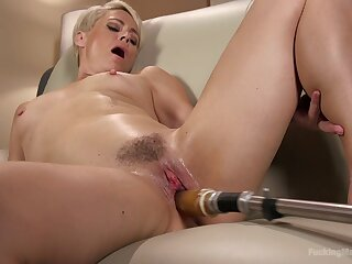 Short haired blonde Helena Locke rides a fucking gadget