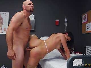 Man with giant flannel fucks the naked nurse together with cums on her face