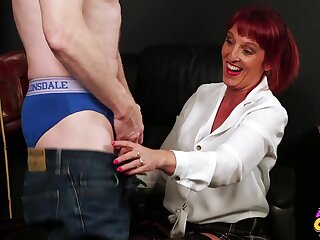 Redheaded Beau Diamonds sucks off a lucky guy and jerks him off