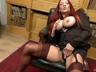 Busty redhead Faye Rampton takes off her panties to masturbate