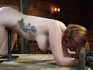Redhead slavegirl is machine fucked and flogged after a long time being tied up